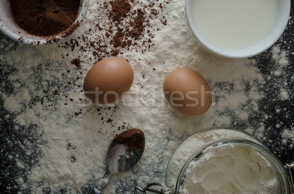 Home eggs, flour and cocoa powder Stock photo © Peteer