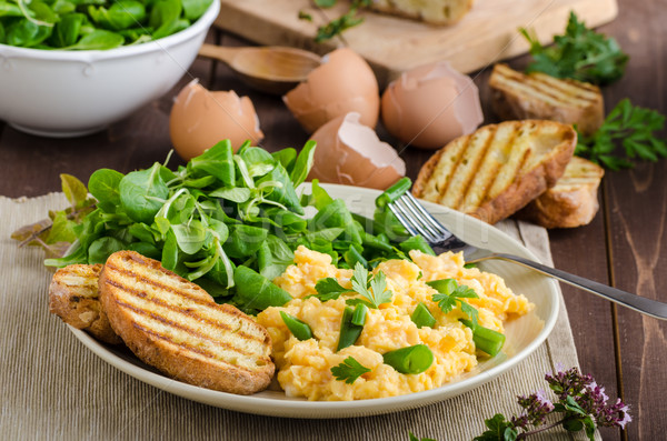 Scrambled eggs with salad Stock photo © Peteer
