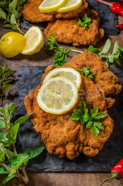 Schnitzel with fries, salad and herbs Stock photo © Peteer