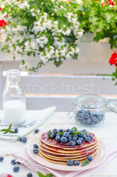 Vintage pancakes outside garden with blueberries Stock photo © Peteer