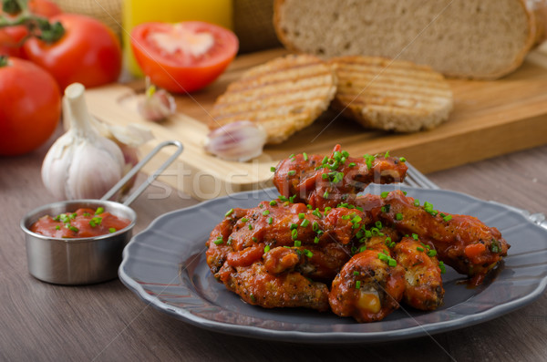 Spicy chicken wings Stock photo © Peteer