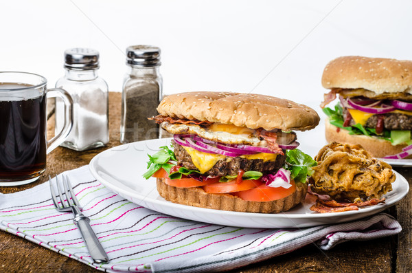 Beef burger, red onion and fried egg Stock photo © Peteer