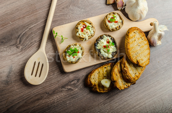 Grilled mushrooms stuffed cheese and chilli Stock photo © Peteer