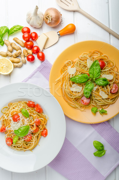 Lemon pasta with cherry tomatoes, basil and nuts Stock photo © Peteer