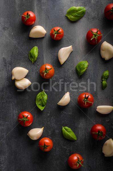 Tomato garlic basil background Stock photo © Peteer