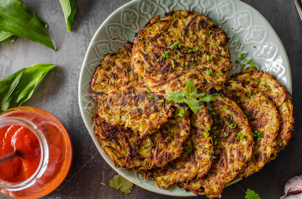Potato pancakes fried with garlic Stock photo © Peteer
