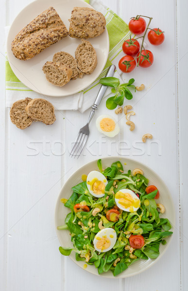 Lamb's lettuce salad with eggs and nuts Stock photo © Peteer