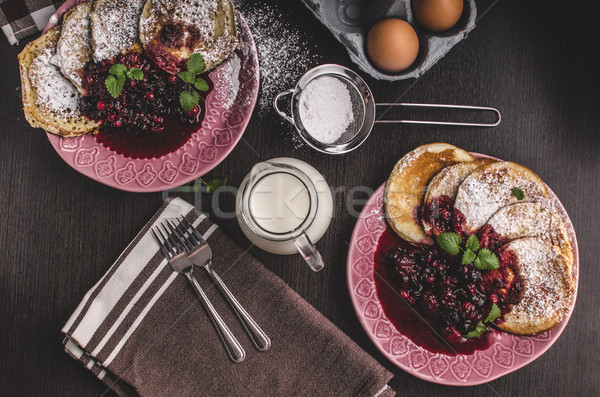 Stock photo: Crepes pancakes with berries reduction