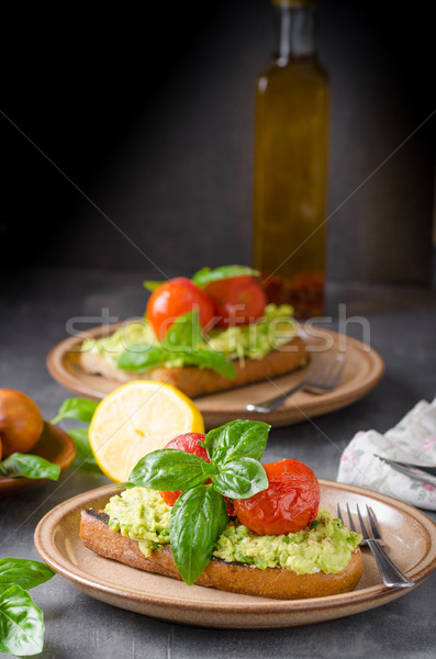 Avocado spread bread with baked tomato Stock photo © Peteer