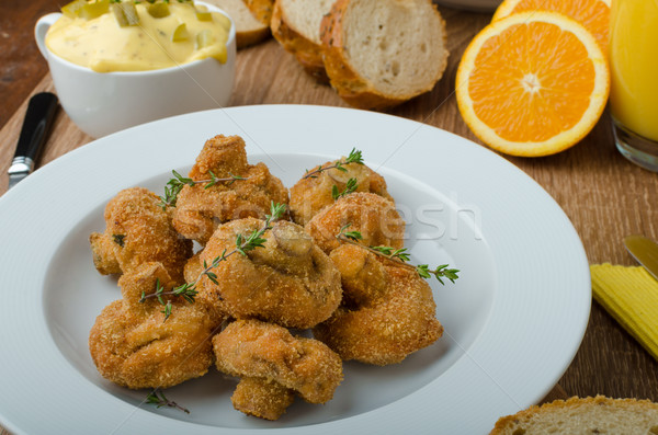 Breaded fried mushrooms with juice Stock photo © Peteer