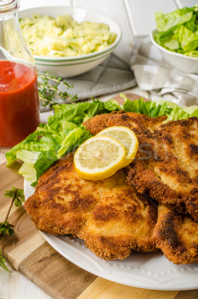 Delicious schnitzel with salad Stock photo © Peteer