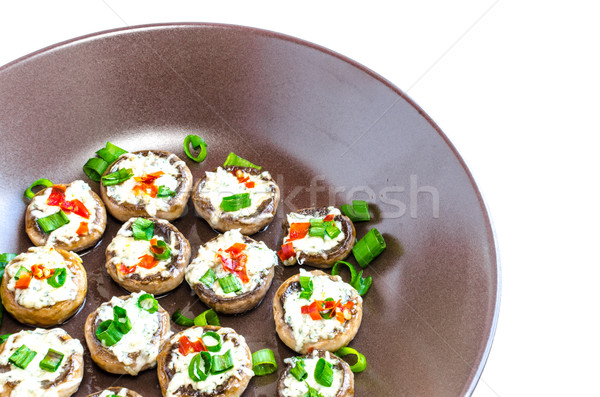 Baked muhrooms with blue cheese, red pepper and spring onion Stock photo © Peteer