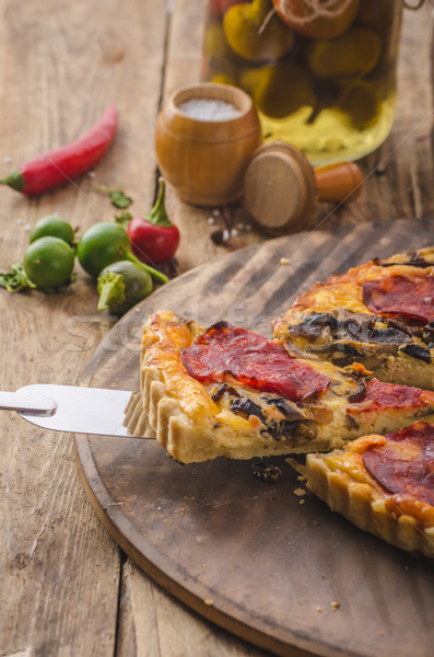 Delicious quiche with chorizo, nuts and sharp cheese Stock photo © Peteer