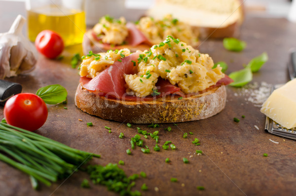 Delicious toasted bread with scrambled eggs Stock photo © Peteer