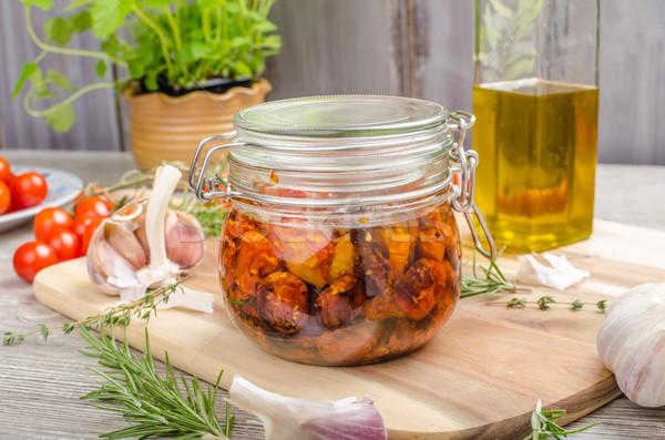 Casero sol secado tomates aceite de oliva ajo Foto stock © Peteer
