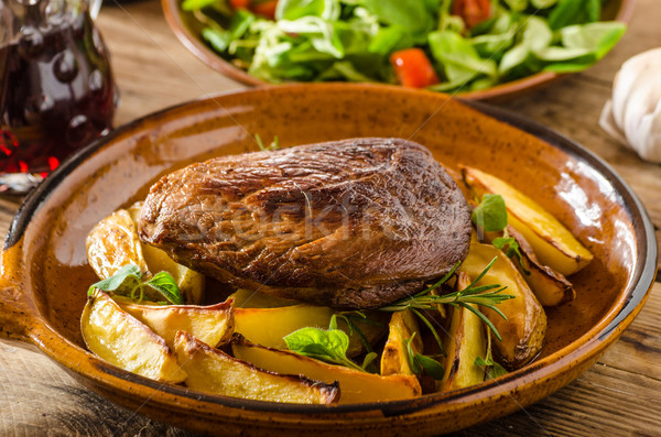 Beef steak with herbs and wine Stock photo © Peteer