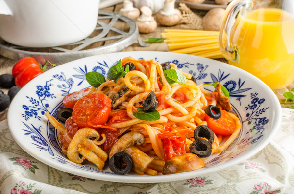 Pasta with olives, tomatoes and basil Stock photo © Peteer