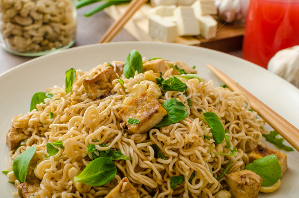 Chinese noodles with tofu and cashew nuts Stock photo © Peteer