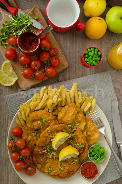 Schnitzel, french fries and microgreens salad Stock photo © Peteer