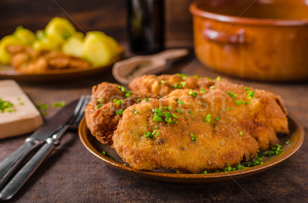 Wiener schnitzel with potatoes Stock photo © Peteer