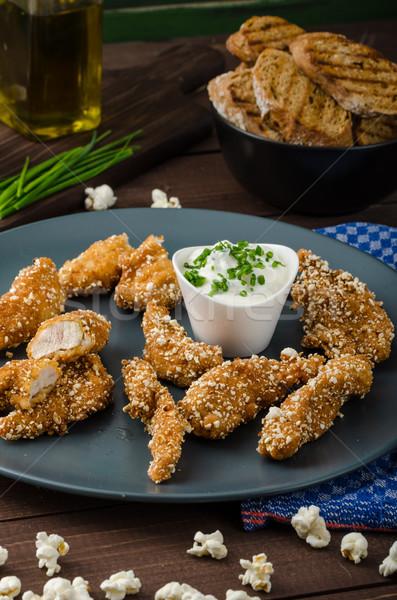 Chicken strips in popcorn breadcrumbs Stock photo © Peteer