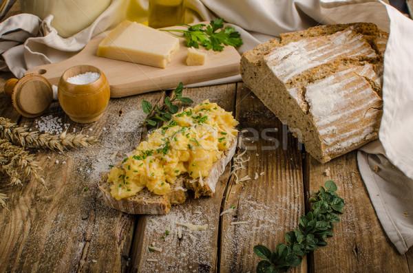 Scrambled eggs on homemade bread Stock photo © Peteer