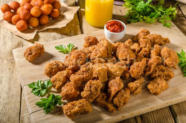 Delicious chicken popcorn Stock photo © Peteer
