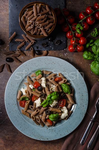 Całość ziarna makaronu ser pomidorów bazylia Zdjęcia stock © Peteer