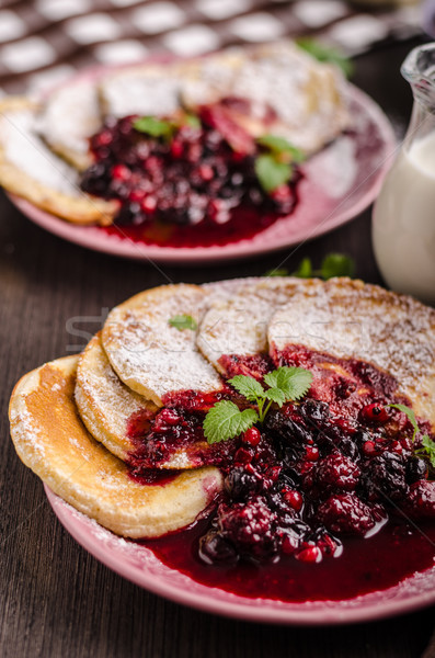 Crepes pancakes with berries reduction Stock photo © Peteer