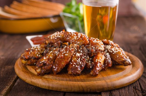 Gegrilde kip vleugels hete saus voedsel fotografie klaar Stockfoto © Peteer