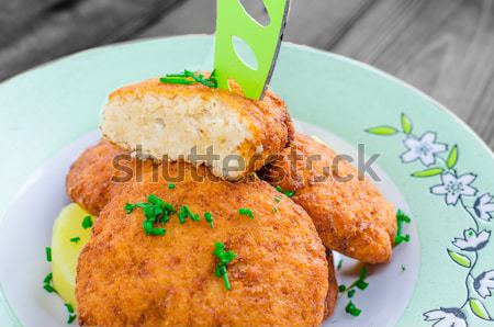 Homemade potato croquettes with parmesan and chives Stock photo © Peteer