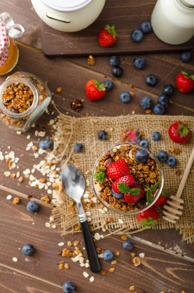 Joghurt sült granola bogyók kicsi üveg Stock fotó © Peteer