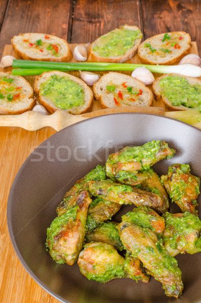 Roasted chicken wings with Chimichurri Stock photo © Peteer