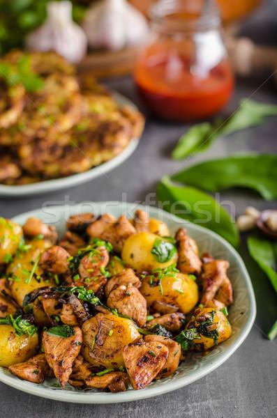 Stock photo: Potato pancakes, fried chicken with potatoes