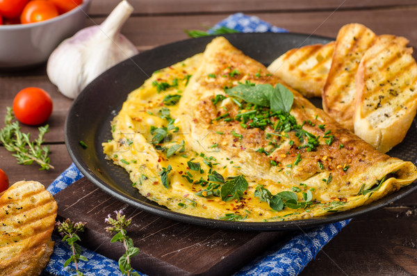 Herb omelette with chives and oregano sprinkled with Herb omelette with chili flakes Stock photo © Peteer