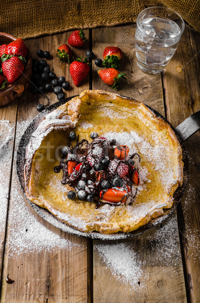 Dutch Baby Pancakes with berries and chocolate Stock photo © Peteer