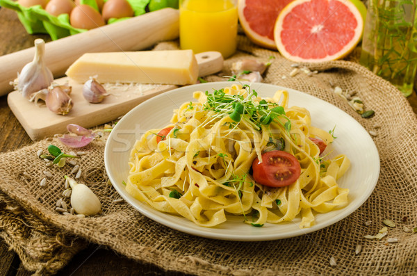 Semolina pasta with roasted garlic, sprinkled microherbs Stock photo © Peteer