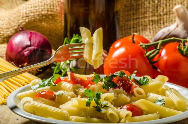 Stok fotoğraf: Lezzetli · makarna · domates · otlar · parmesan · peyniri · restoran