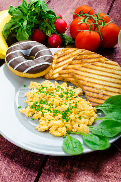 Healthy breakfast scrambled eggs with chive, panini toast Stock photo © Peteer