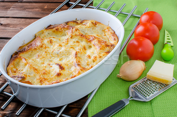 Lasagne bolognese in a baking dish Stock photo © Peteer