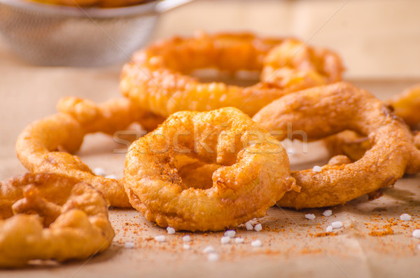 Stock photo: Onion rings with chili on top