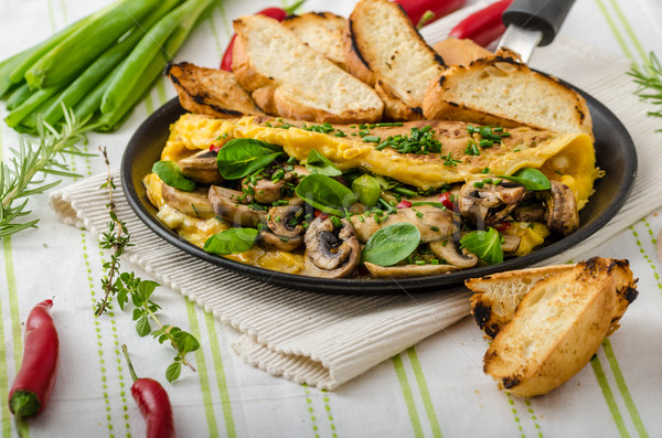 Stock photo: Omelet with mushrooms, lamb's lettuce, herbs and chilli