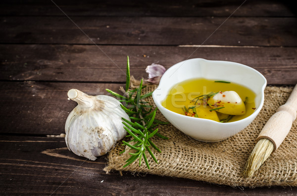 Seasoned olive oil, garlic and rosemary Stock photo © Peteer