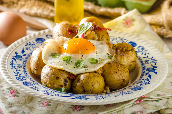 Baked potato with chili and fried egg Stock photo © Peteer