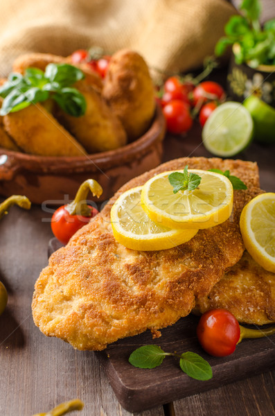 Chicken schnitzel with croquettes Stock photo © Peteer