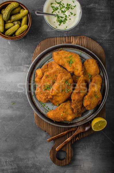 Breaded original schnitzel Stock photo © Peteer