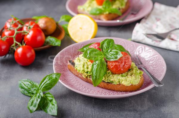 Avocado spread bread with baked tomato Stock photo © Peteer