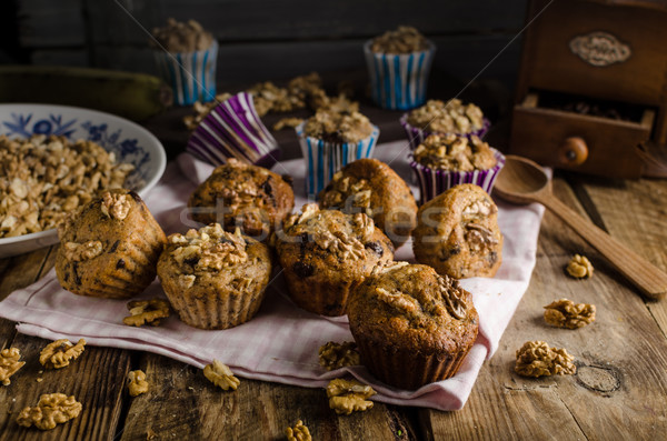 Whole grain muffins with dark chocolate and nuts Stock photo © Peteer