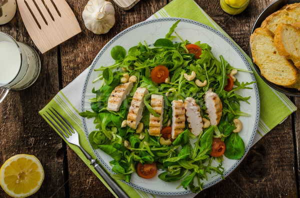 Arugula and lamb's lettuce with grilled chiken Stock photo © Peteer