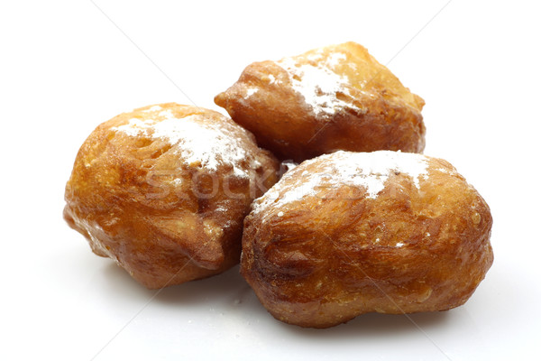 freshly baked traditional dutch oliebollen with powdered sugar Stock photo © peter_zijlstra